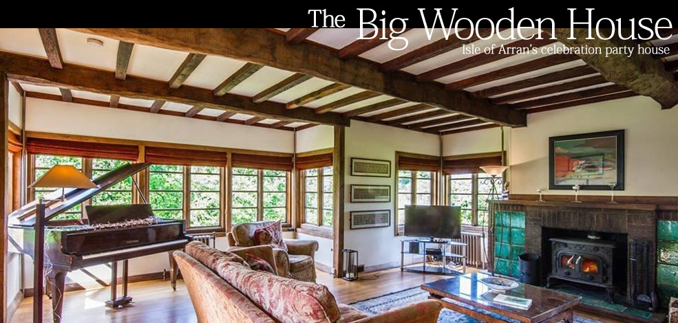 Big Wooden House living room wood buring stove and sea views